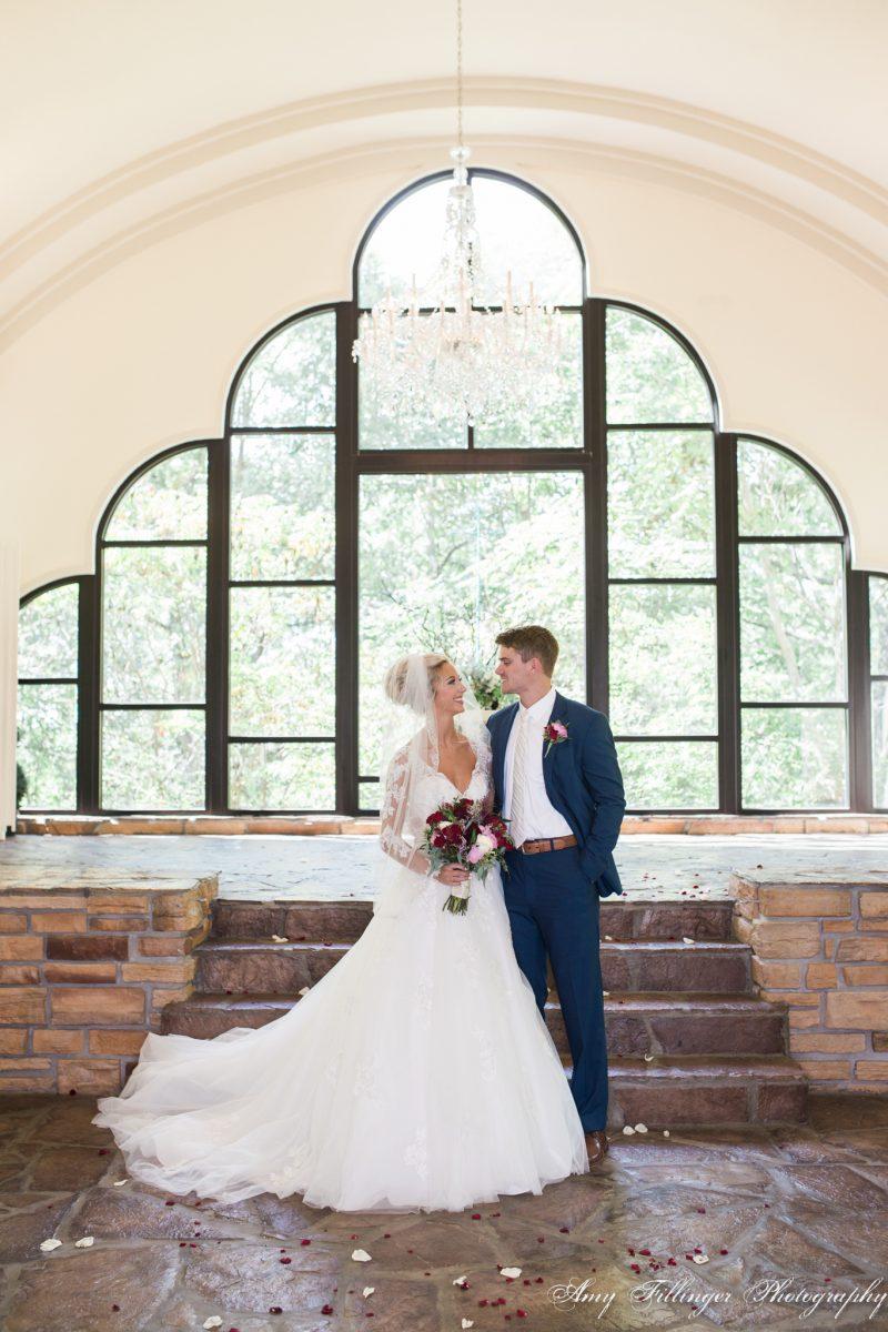 Will and Ashtyn's Stonegate Glass Chapel wedding, Branson wedding photographer. #bransonweddingphotographer #bransonwedding #stonegateglasschapel